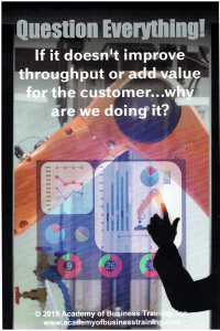 Poster with a robotic arm in the background and an MRP dashboard imposed over it. Title is Questions Everything! If it doesn't improve throughput or add value for the customer...why are we doing it?