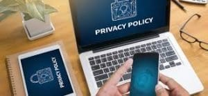 Image of a laptop with the word PRIVACY POLICY on the screen.